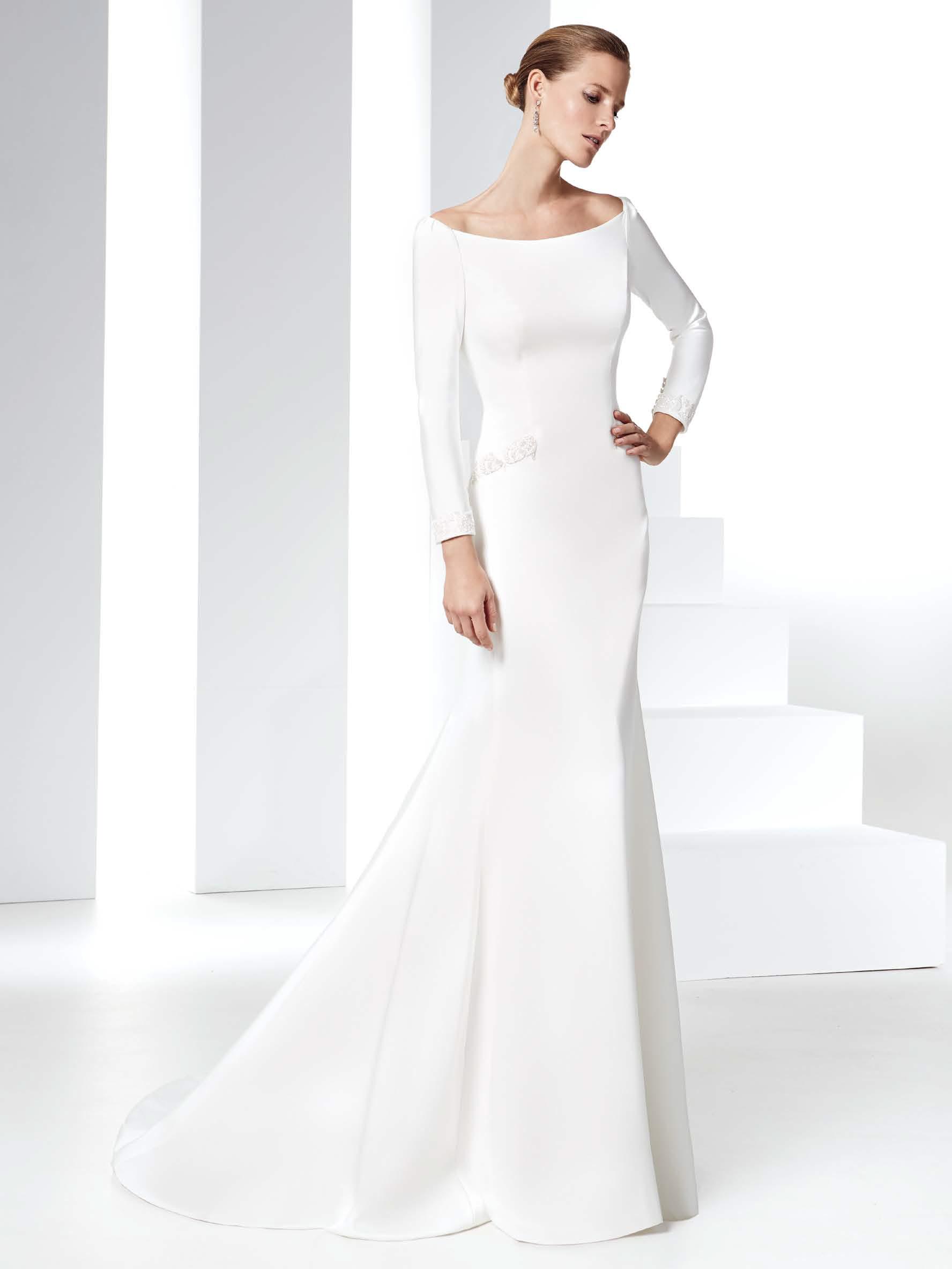 Maniche lunghe vestiti sposa 2016 esempio Raimon Bundo. Le maniche lunghe  come trend glamour degli abiti da ... b8bc77cd74c